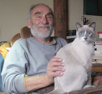 "Emanuele Corso, ""looking like an old Sicilian,"" with ""genius cat"" Sheba"