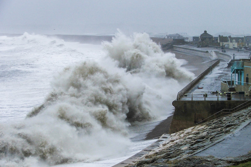 Waves crashing onto Chesil Beach in Dorset during the winter of 2013/14. Credit: Tim Poate/University of Plymouth